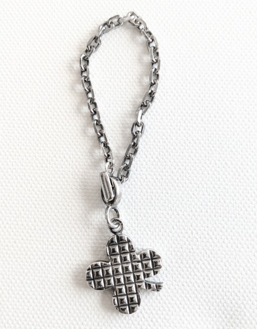 chanel clover charm